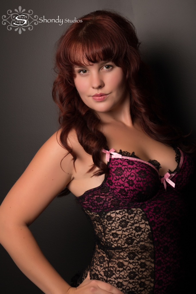 portrait of woman in black and pink lingerie
