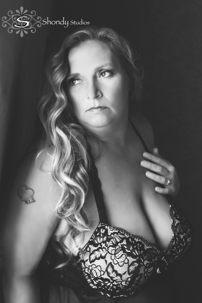natural light black and white woman in black lingerie looking away
